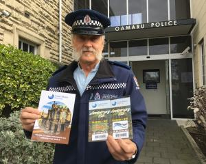 Senior Constable Bruce Dow, of Oamaru, with examples of correspondence that has been sent to...