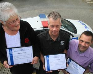 Barbara Pereira, Raimon Bol (centre) and Tony Clement, all of Oamaru, were awarded with the...