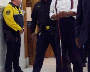 Bill Cosby departs the Montgomery County Courthouse in handcuffs after being sentenced in his...