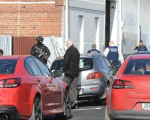 Police surround a warehouse in South Dunedin. Photo: Gerard O'Brien