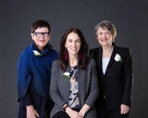 Former Prime Minister Jenny Shipley, left, current Prime Minister Jacinda Ardern, centre, and...