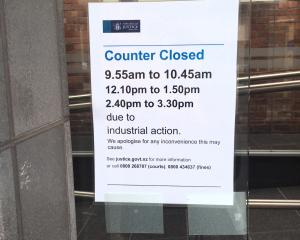 A sign at the entrance to the Dunedin District Court. Photo: Rob Kidd