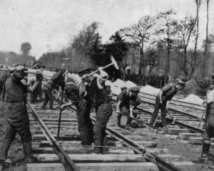 Rapid railway construction in France: Troops laying a broad-gauge line at the rate of one mile a...