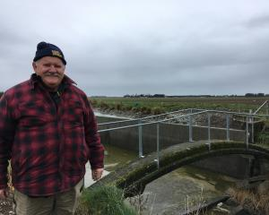 Retiring water ranger Dave O'Donnell stands on a 1950s bridge over the old Ashburton Lyndhurst...