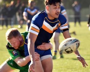 Tama Apineru, of the Otago Whalers, is tackled by David Hall, of the Aoraki Eels, during the...