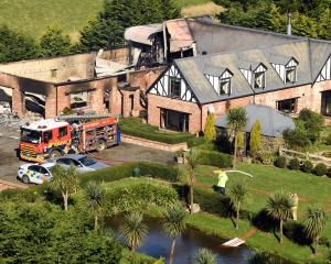 An Otago Peninsula house partially consumed by fire earlier this year. An investigation was...