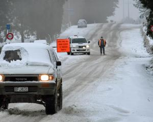A motorist with his vehicle covered in snow rolls into Dunedin yesterday near Three Mile Hill Rd,...