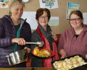 The Hub free meals team (from left) Pip Gardyne, Heather Gullick and Sarah Cowan dish up a hot...