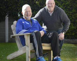 Dave Griffin (59) and Roy Robertson (70) with the chair they built together following Mr Griffin...