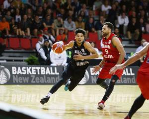 Tai Webster takes the ball to the hoop for the Tall Blacks as Lebanon's Ahmad Ibrahim guards him....