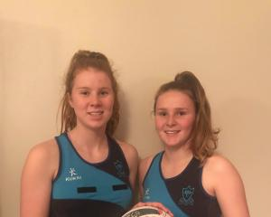 Cindy (left) and Laura Weller, after a successful netball season in which they were both named on...