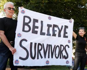 Activists hold a protest and rally in support of Christine Blasey Ford, the university professor...