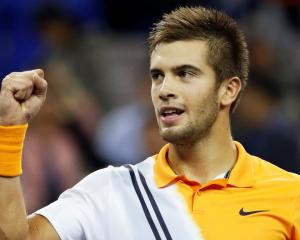 Borna Coric celebrates his victory over Roger Federer. Photo: Reuters