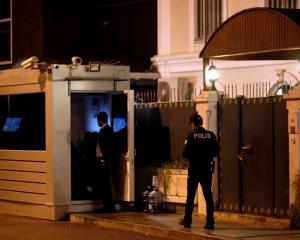 Police wait for forensic experts to arrive at a residence of Consul General of Saudi Arabia...