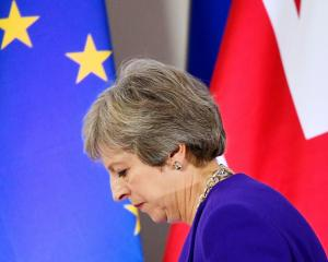 Britain's Prime Minister Theresa May leaves a news conference at the European Union leaders...