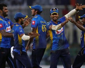 Sri Lankan players celebrate the dismissal of England's Sam Curran. Photo: Reuters