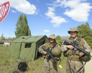 Keeping the 3rd Combat Service Support Team's camp near Roxburgh Dam safe are Privates Jazz Rou ...