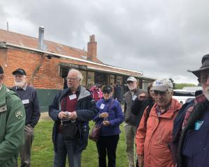 Mining enthusiasts and historians pay a visit to the Lawrence Chinese Camp yesterday as part of...