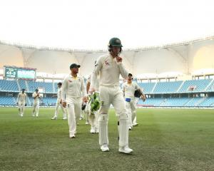 Australia cricketers leave the field after a tough first day against Pakistan. Photo: Getty Images