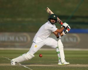 Azhar Ali plays the ball through the offside for Pakistan during day two of its test against...