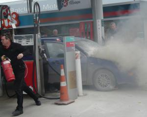 The engine of a car caught fire on the forecourt of the Balclutha Caltex this afternoon. Photo:...