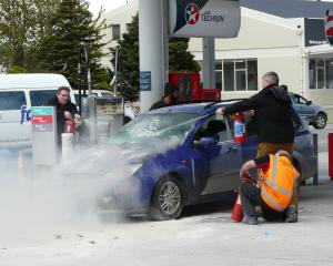 Caltex Balclutha staff and members of the public unite to control a vehicle engine fire on the...
