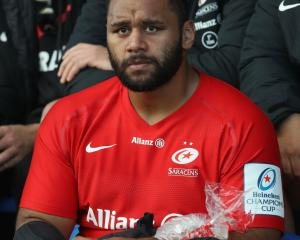 Billy Vunipola looks on with an ice pack on his broken arm. Photo: Getty Images