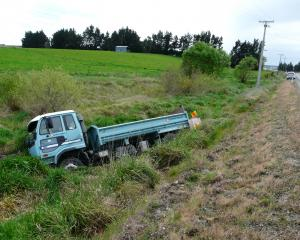 A gravel truck rests in swampy ground off the Owaka Highway near Finegand yesterday. It left the...