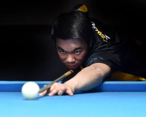Dunedin 8-ball player Brendan Ng lines up the black during a practice session at Bowey's Pool...