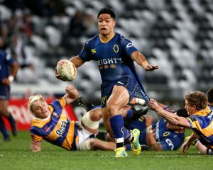 Josh Ioane of Otago breaks the tackle of Richard Judd of Bay of Plenty during the round eight...