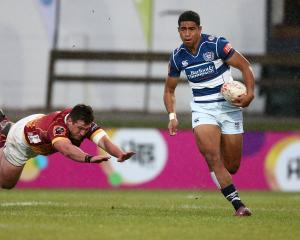 Auckland's Salesi Rayasi slips away from Southland's Shaun Stodart to score a try in a Mitre 10...