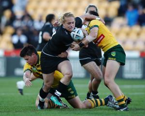 New Zealand's Amber Kani on the charge against the Australian Jillaroos. Photo: Getty