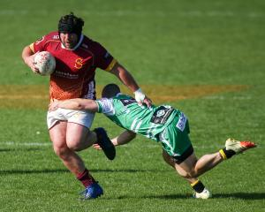 Southland prop Morgan Mitchell is tackled by Manawatu halfback Kayne Hammington during their...
