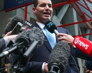 Jami-Lee Ross speaks to media outside Wellington Police Station yesterday. Photo: Getty Images