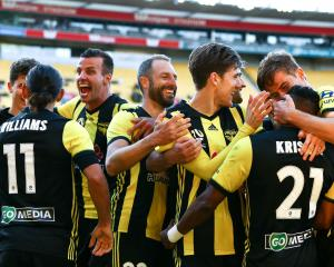 Wellington Phoenix players celebrate Roy Krishna's late winner over the Newcastle Jets. Photo:...