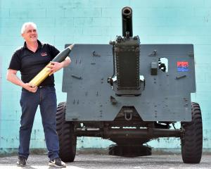 Artillery aficionado Robbie Gardiner with a 25-pound artillery piece owned by the Dunedin RSA...