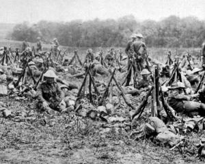 New Zealand troops who attended a horse show on the western front had their weapons close by and...