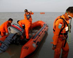 Rescue team prepares boat for Lion Air flight JT610 crash site off the coast of Karawang regency....