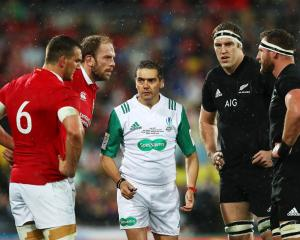 Jerome Garces talks to Lions Sam Warburton and Alun Wyn-Jones and All Blacks Brodie Retallick and...