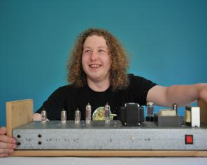 Logan Park High School pupil Karl Brinsdon with the amplifier he designed. Photo: Gregor Richardson
