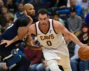 Cleveland Cavaliers forward Kevin Love drives past Minnesota Timberwolves forward Taj Gibson last...