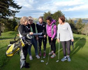Discussing the evening's draw at the Otago Golf Club's Balmacewen course  are (from left) former...