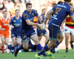 Michael Collins looks to pass the ball for Otago during Saturday's Ranfurly Shield win against...