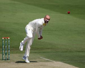 Nathan Lyon bowls for Australia in the second test against Pakistan. Photo: Getty Images