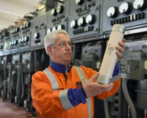 Aurora asset reliability engineer David Paterson holds a 6.6kV, 160amp HRC fuse at the soon-to-be...