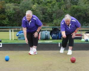 Twins Rose Johnson (left) and Wendy Watson send down a couple of bowls at the South Island...