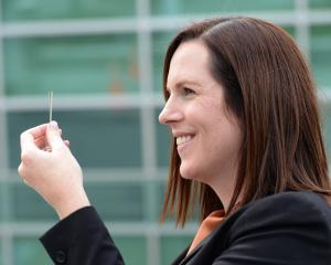 Research and Education Advanced Network NZ chief executive Nicole Ferguson holds part of a fibre...