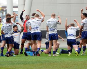 The Otago team in a friendly moment at Forsyth Barr Stadium earlier this week. Photo: Linda...