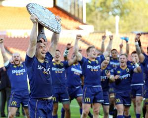 Otago's Michael Collings celebrates with the Ranfurly Shield during the round nine Mitre 10 Cup...