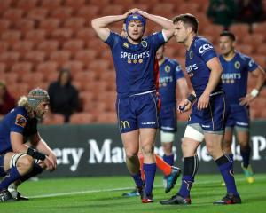 Otago's James Lentjes (centre) looks dejected during the Mitre 10 Cup Championship Final against...